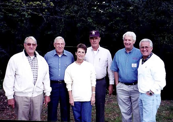 Charter Board Members gather for a photo at a 25th Anniversary Meeting Celebration in 1999