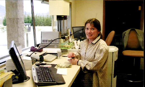 Photo of Carolina Mountains Credit Union employee Patricia Foxx Norton at her desk.